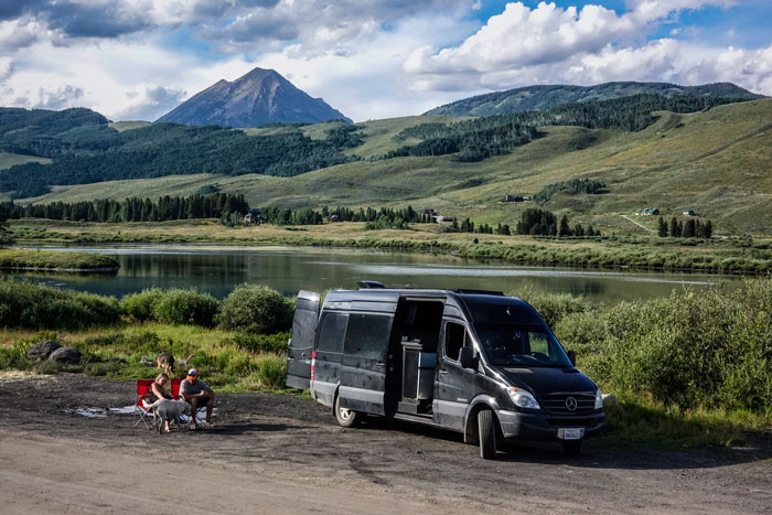 Freedom Vans founder Tom Doran and partner, Kyleigh Rogers, take life to the road in their Sprinter van with pups, Cleo and Moby (Devon Balet Photography).