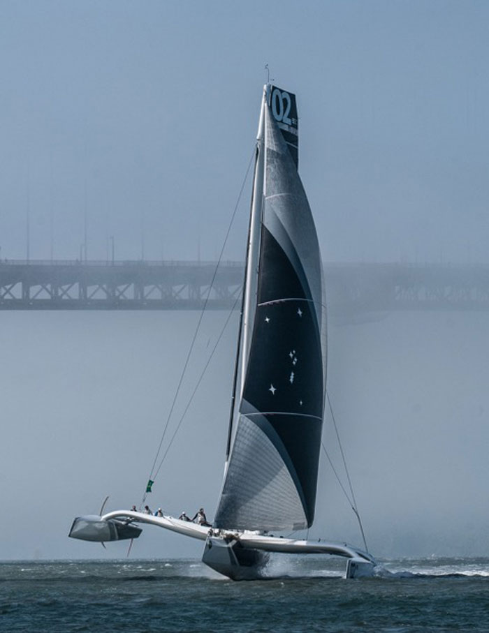 Fog is common during a San Francisco Bay summer. Orion's powerful underwater foil lifts the boat as she powers up while sailing downwind in perfect flat water conditions (Pressure Drop/Erik Simonson).
