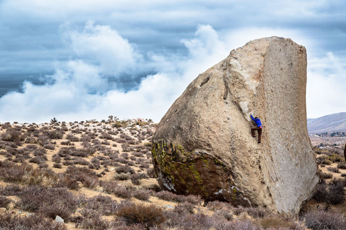 Will Stanhope runs an afternoon lap on the area classic, Southwest Arete, of the Grandma Peabody Boulder in the iconic Buttermilk.