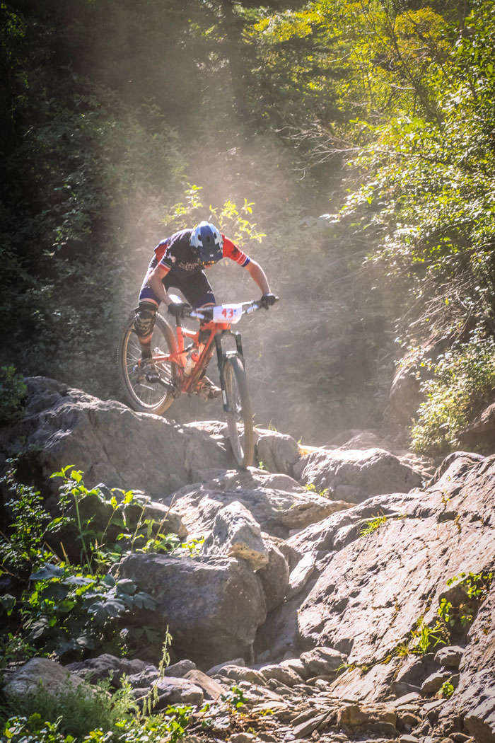 Larry Sussman smashes rocks during the DH race (Mike Oitzman).