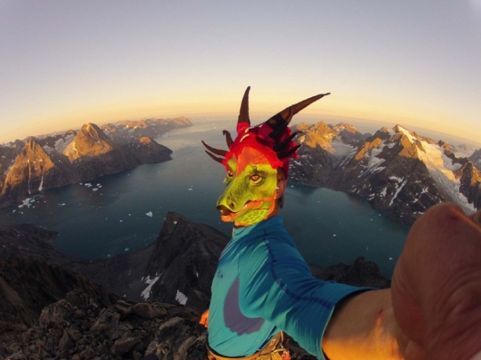 Mike Libecki on a summit in Greenland wearing a Year of the Dragon mask. Photo Mike Libecki