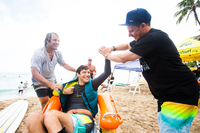 Roy cheers on a fellow competitor at Duke's Ocean Fest. Photo: Trevor Clark.
