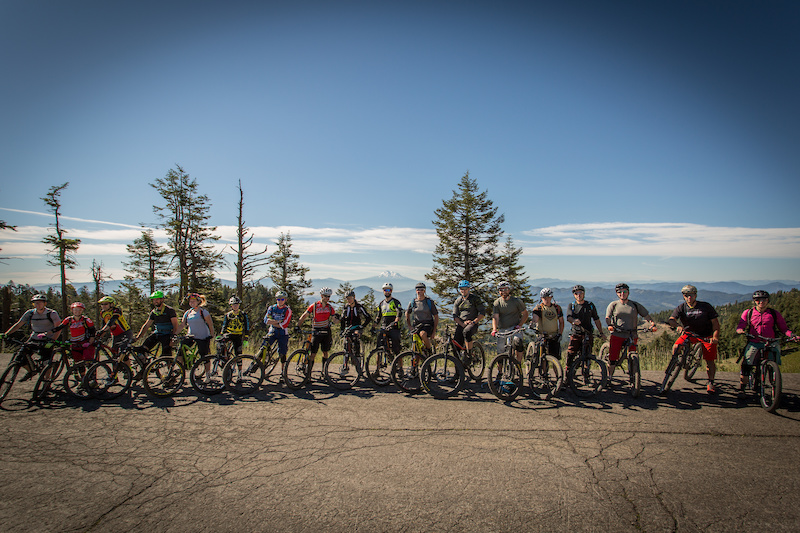 Race organizer Ashland Mountain Adventures shuttled riders to the top of Mount Ashland for practice runs. Check out Mt. Shasta in the distance, towering 12,000 feet above the floor at its base. Photo: Called to Creation.