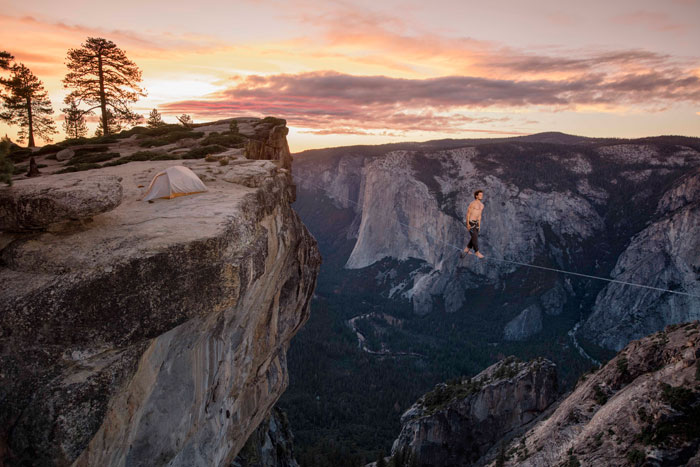Taft Point, Yosemite National Park. Caio Afeto keeping calm as he walks the line with 3,000 feet of air below his feet.