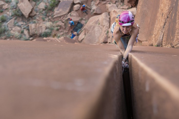 Brette Harrington climbing a wide crack in Indian Creek. Photo by Drew Smith