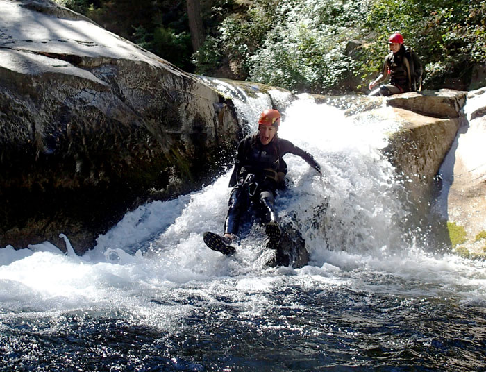 Author Leonie Sherman on a natural water slide.