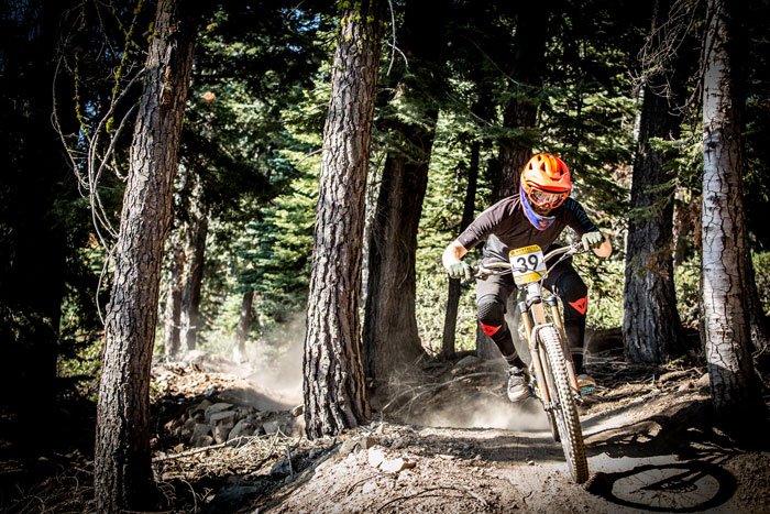 Evan Turpen splits the trees on stage 1 on his way to 5th place Pro Men that day and in the top 10 overall. The Northstar Enduro challenged all competitors with loose moon dust and burly rocks over two days of action packed racing. Photo: Called to Creation.