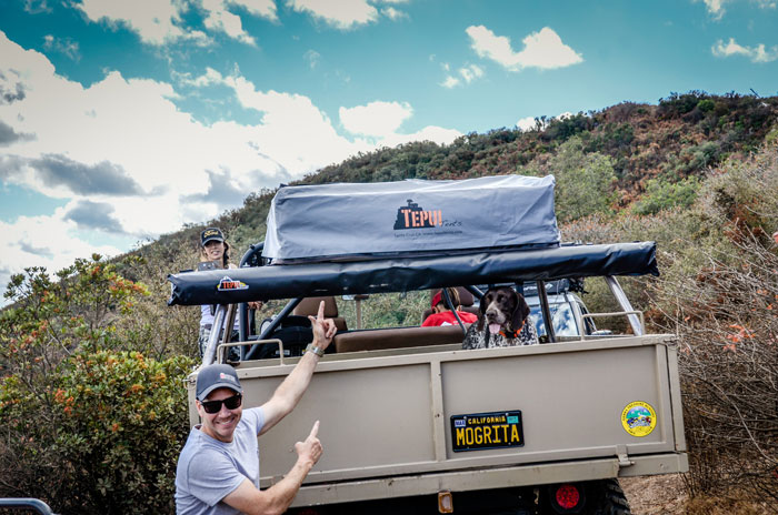 "Carl Meyer shows off his vehicle, ""Unimog,"" featuring a Tepui tent and an extra awning which stay mounted as he does offroad trail runs. Photo: Tom Owen."