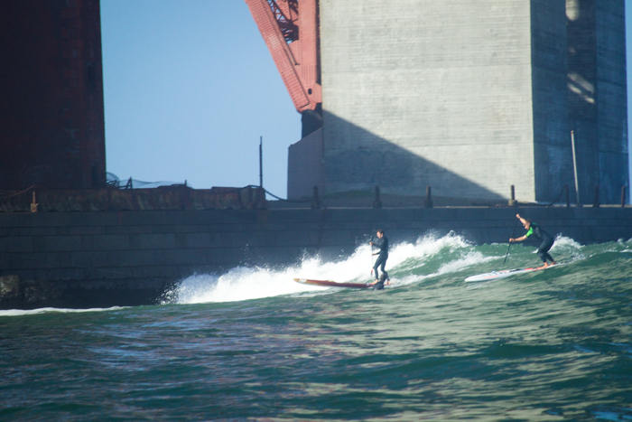 Heavy Water competitors catch waves at Fort Point during the lay day. Photo: Joe Spota