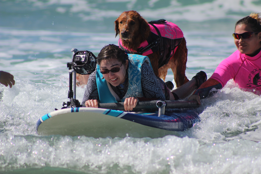Every 65 minutes a veteran with PTSD takes their life by suicide. We are dedicated to improving the lives of our physically and emotionally wounded war heroes. Military service members like Esther volunteer to be on the water team to help K9 assisted surfers like Alesha. This responsibility fosters trust and gives them both a sense of connection to each other and the team.