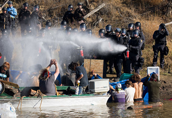 Pipeline protesters and police on November 2, 2016. Photo: Pat Clayton.
