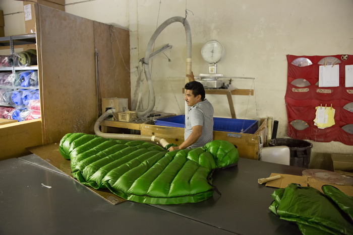 A Versalite bag being filled at the Western Mountaineering factory.