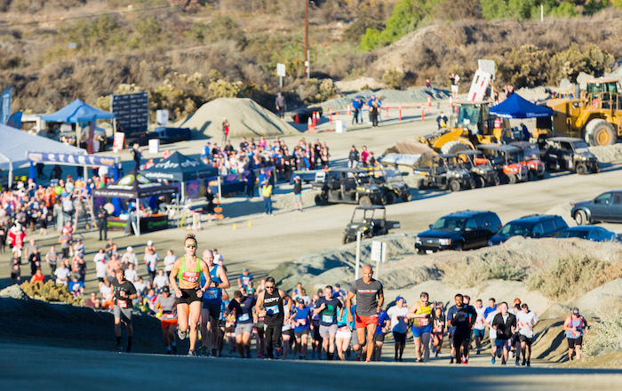 Courtney Langer, the first place Single Crusher female winner, leads the charge up the first hill of the 2018 Quarry Crusher Run.