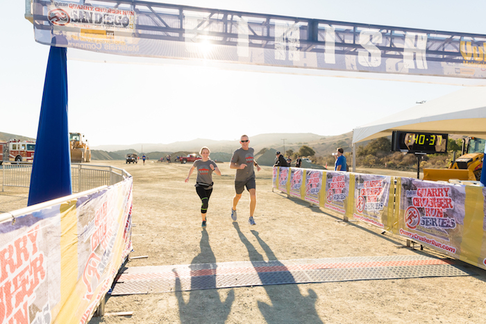 A happy couple crosses the finish line of the 2nd Annual Quarry Crusher Run in support of the Chula Vista Firefighter's Foundation.