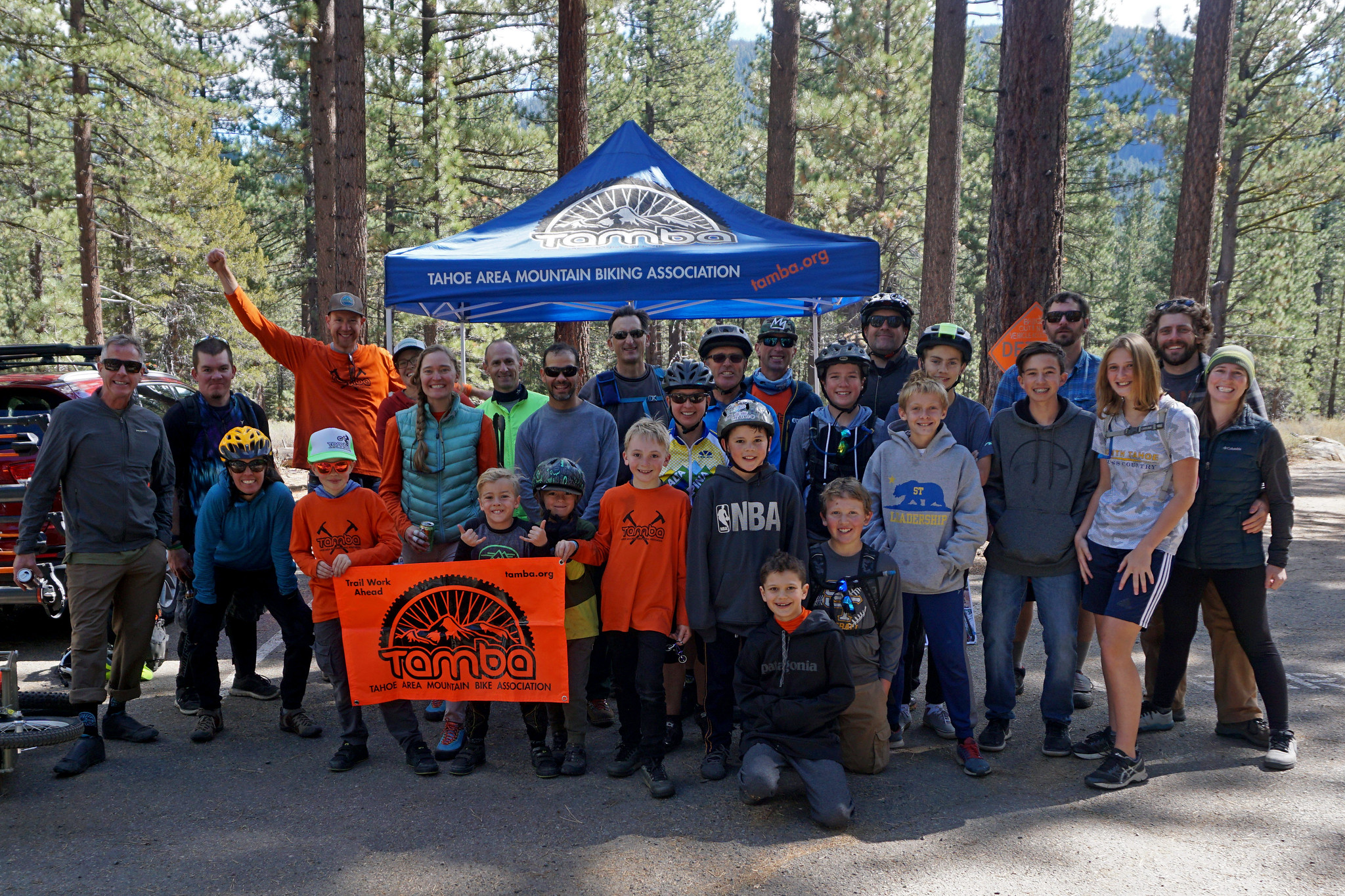 A group of people who volunteered for mountain biking organization TAMBA.