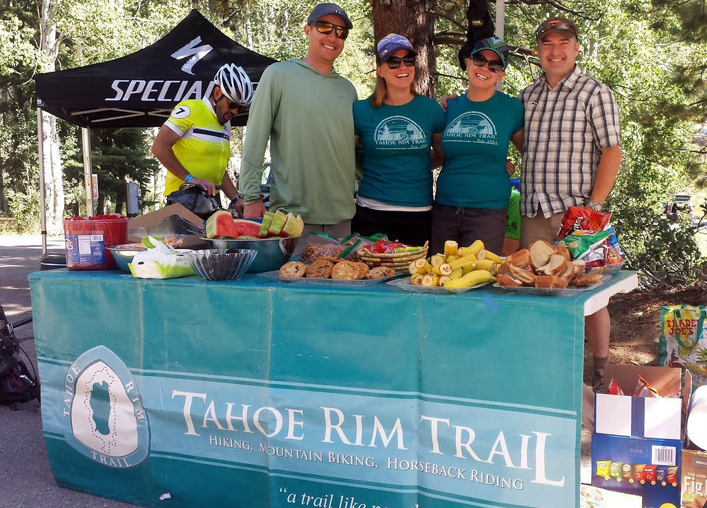 Volunteers man a table of refreshments for athletes participating in the Rose to Toads ride.