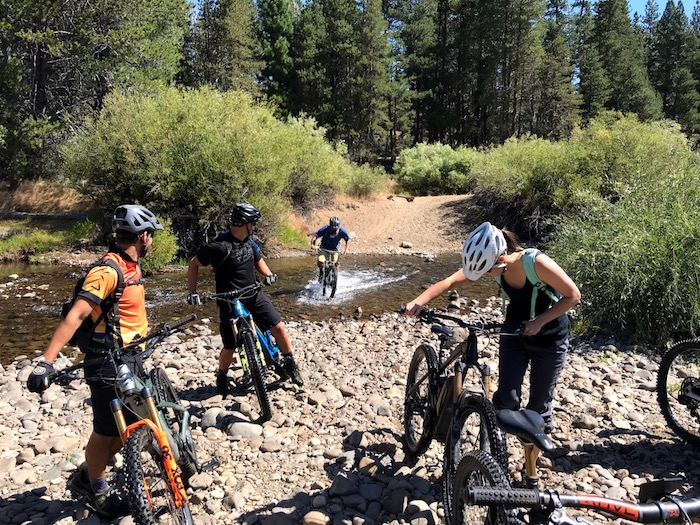 Cyclists enjoy riding electric mountain bikes in Downieville.