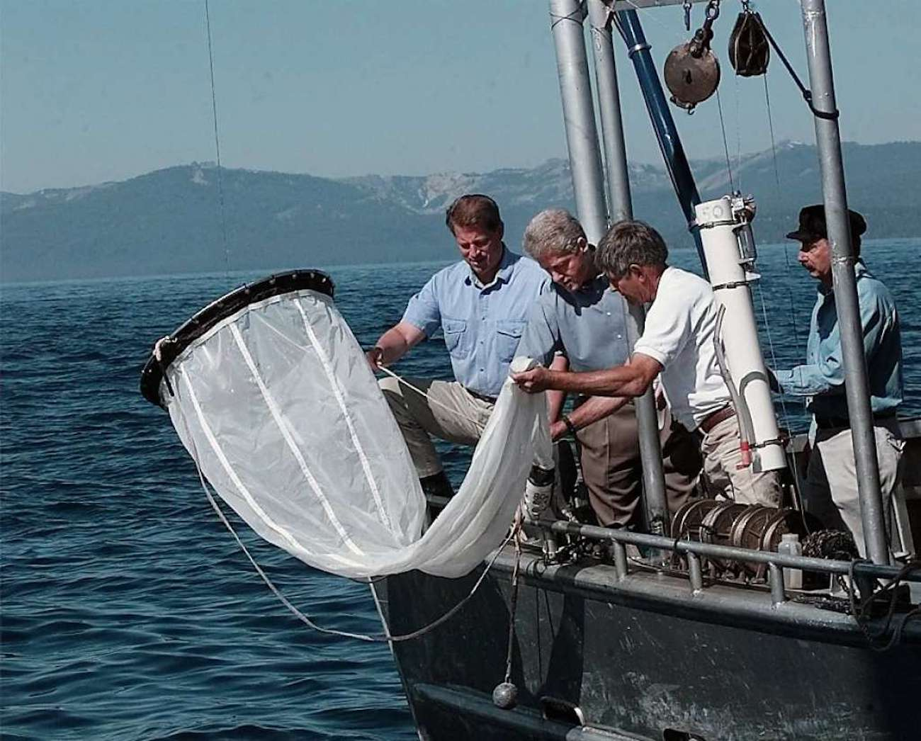Al Gore and Bill Clinton on a boat with Keep Tahoe Blue scientists.