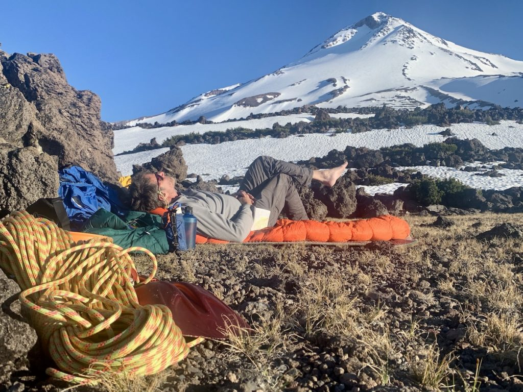 Mount Shasta Inspires, Image of man laying in front of Mount Shasta