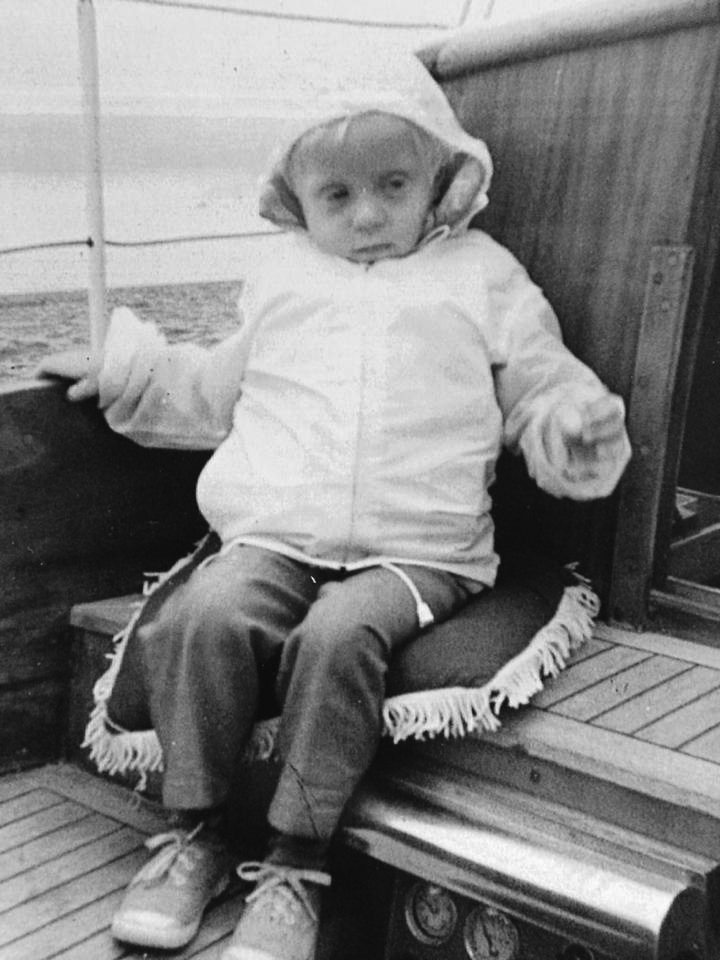 Photo of Rikki Eriksen as a child on her father's boat