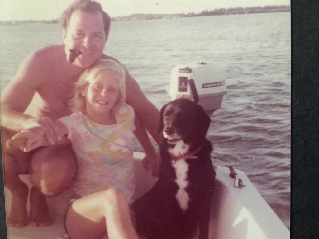 Rikki Eriksen sailing on Indian RIver Florida with her dad and dog