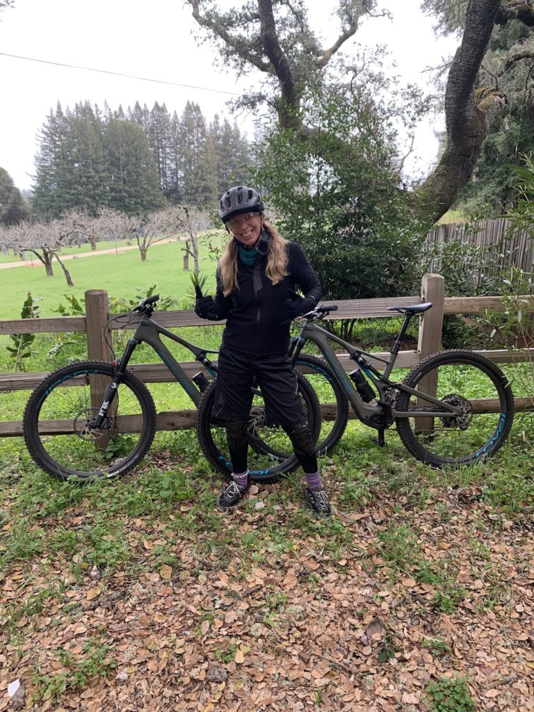 The eMTB Evolution author in front of her two Turbo LEVOs