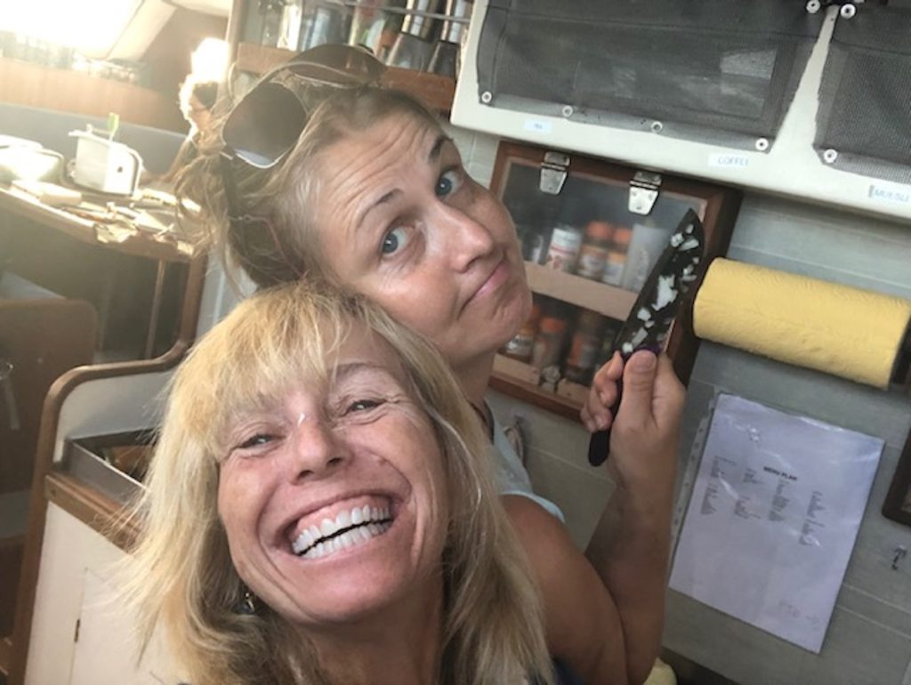 Rikki Eriksen smiling in the galley of eXXpedition