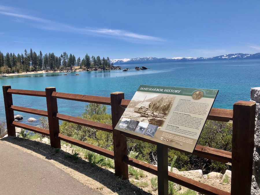 An educational sign along the east shore of Lake Tahoe. This sign shows information about the history of Sand Harbor.