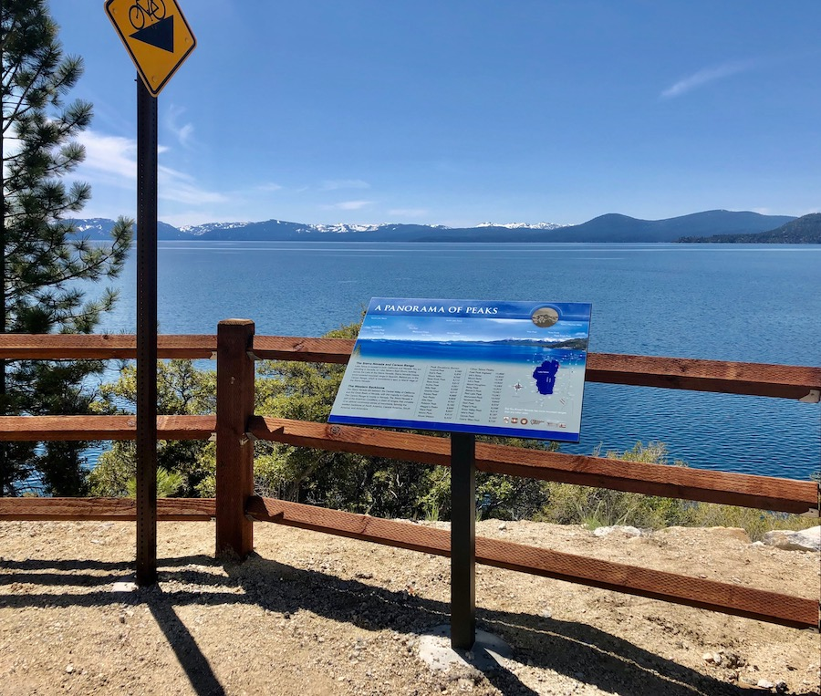 An educational sign on the east shore with information about the mountain peaks around Lake Tahoe.