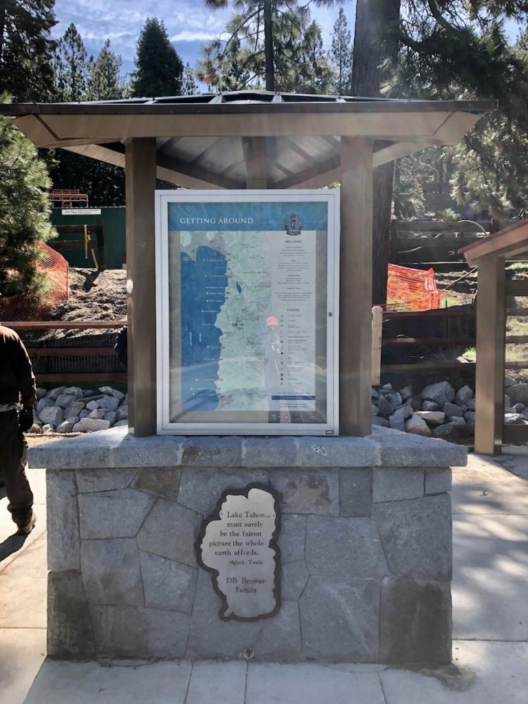 Large educational sign placed on a granite boulder showing a map of Lake Tahoe.