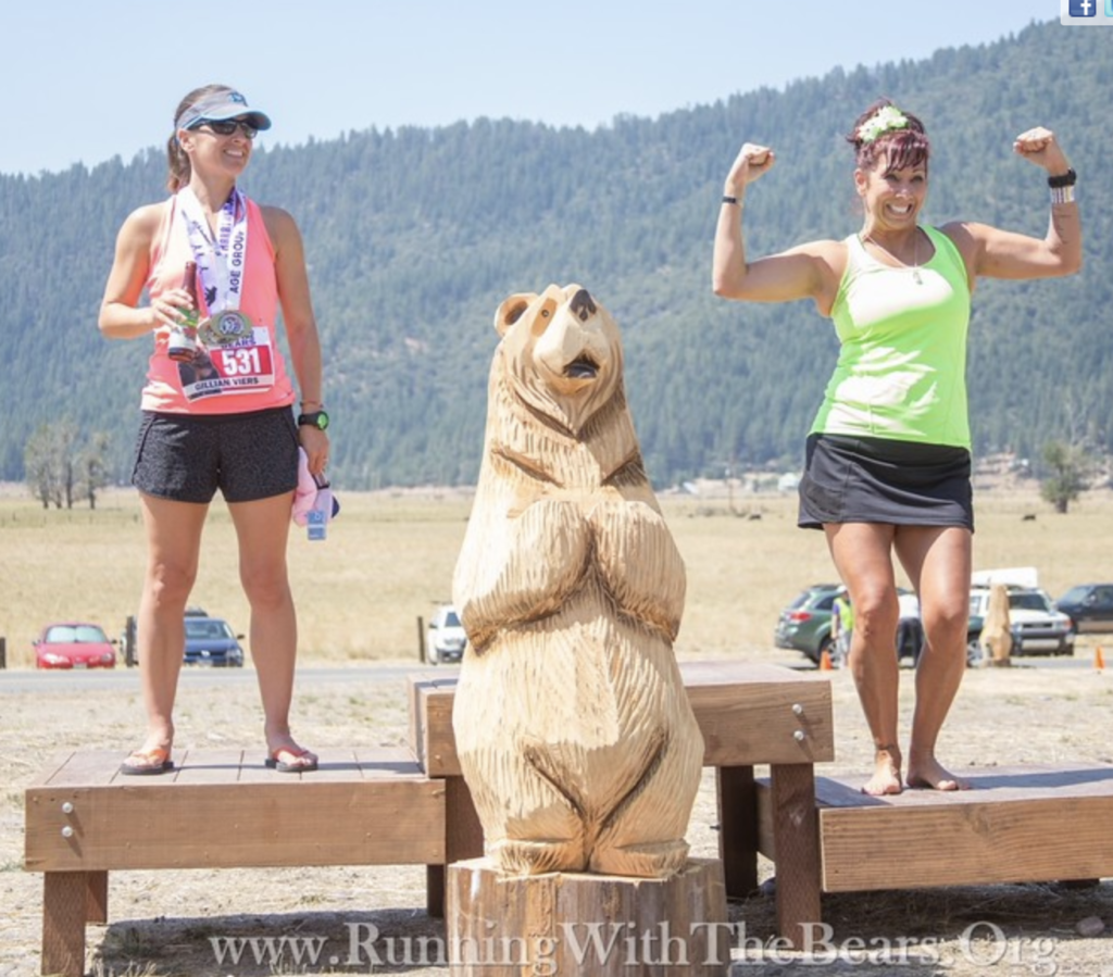 Two women at the Running with the Bears Podium