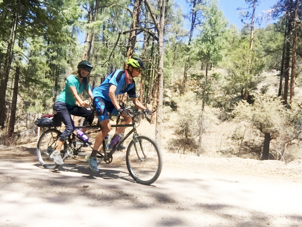 a couple riding a tandem bike
